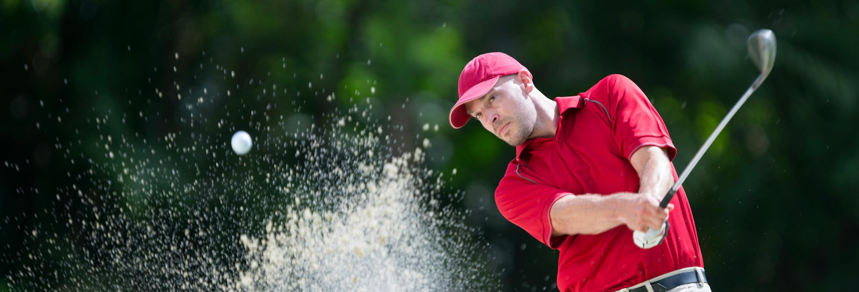 Golfer playing shot
